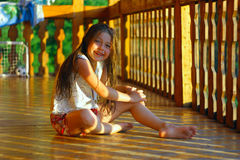 Little girl in the wooden house Stock Photography