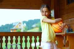 Little girl in the wooden house Stock Image