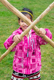 Little girl with wooden stick pole doing cross in fun fight. Trying to stop others royalty free stock photo