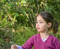 Little girl in woods Stock Photo