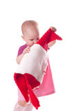 Little girl with wool dress in hands Royalty Free Stock Photos