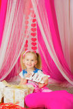 Little girl with a  word baby in pink  skirt Stock Images