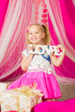Little girl with   word love in pink  skirt Stock Photography