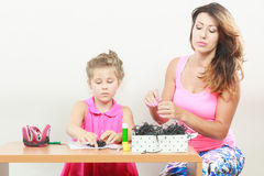 Little girl work with mom Royalty Free Stock Photo