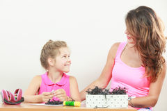 Little girl work with mom Stock Photography