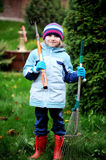 Little girl working in the autumn garden Royalty Free Stock Photography