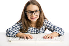 Little girl working with a computer Stock Photo