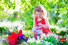 Little girl working in the garden Royalty Free Stock Photography