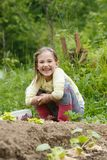 Little girl working in the garden stock photos