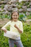 Little girl working in the garden. Little girl having fun in the garden, planting, gardening, helping her mother. Happy, natural childhood concept royalty free stock image