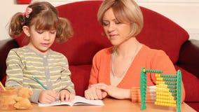 Little girl working her homework stock video footage