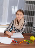 Little girl working on her school project at home. Stock Photo