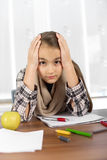 Little girl working on her school project at home. Royalty Free Stock Photos