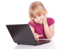 Little girl working on laptop Royalty Free Stock Photos