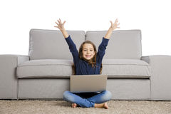 Little girl working with a laptop Stock Photo