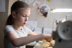 Little girl working. Stock Image