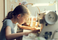 Little girl working. Stock Images