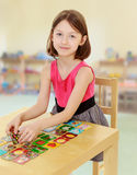 Little girl working at the table Stock Images
