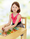 Little girl working at the table Stock Photos