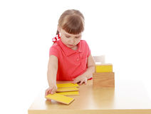 Little girl working at the table Montessori Stock Photography