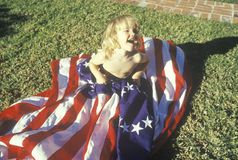 Little Girl Wrapped in American Flag, United States Royalty Free Stock Photos