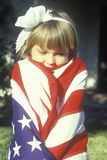 Little Girl Wrapped in American Flag, United States Stock Photo