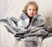 Little girl wrapped in a blanket Royalty Free Stock Photo