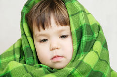 Little girl wrapped in warm blanket,comfortable furnishing Royalty Free Stock Images