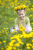 The little girl  with wreath of flowers Royalty Free Stock Image