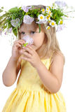 Little girl with a wreath of flowers. Stock Images