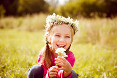 Little girl in wreath of flowers Stock Photo