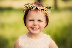 Little girl in wreath of flowers Royalty Free Stock Photography