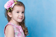 Little Girl with a Wreath in her Hair on  Blue Background Insulated Stock Photos