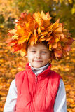 Little girl with  wreath of maple leaves on the head Royalty Free Stock Images
