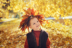 Little girl with wreath of  maple leaves Stock Photography