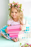 Little girl with wreath and stack of books Royalty Free Stock Photography