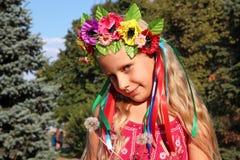 Little girl in wreath. Little girl in ukrainian wreath Royalty Free Stock Photos