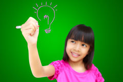 Little girl write ideas on white board Stock Images