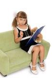 Little girl writes Stock Image