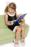 Little girl writes Royalty Free Stock Photography