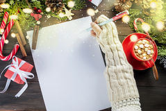 Little girl writes letter to Santa Claus Stock Images