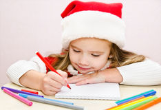 Little girl writes letter to Santa Royalty Free Stock Photo