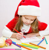 Little girl writes letter to Santa Royalty Free Stock Image