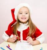 Little girl writes letter to Santa Stock Photography