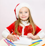 Little girl writes letter to Santa Royalty Free Stock Photography