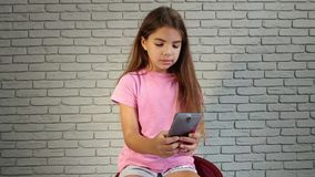 Little girl phone stock video