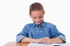 Little girl writing Stock Photos