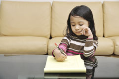 Little Girl Writing Stock Image