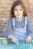 Little girl writing on blackboard Royalty Free Stock Photography