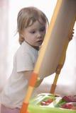 Little Girl Writing On Chalkboard Royalty Free Stock Photography